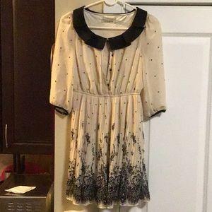 Ladies black and cream pleated dress
